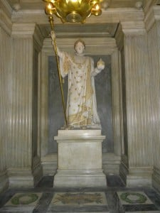 The statue of Napoleon in a chaplet or niche directly opposite (and in a straight line with) the altar and his sarcophagus.
