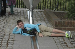 Thing 1 and his cheeky pose at the Prime Meridian line at the Royal Observatory in Greenwich.