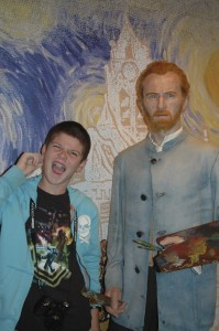 Thing 1 getting cheeky with the wax figure of Vincent Van Gogh.
