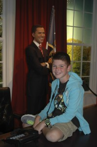 Visiting the Oval Office (in London) and sitting on President Obama's desk!