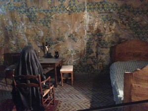 A recreation of Marie Antoinette in her cell at the Conciergerie.