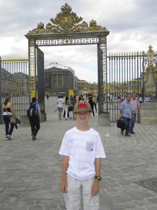 Outside the gold-embellished gate of Versailles . . .