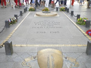 """The Tomb of the Unknown Soldier from World War I under the Arc de Triomphe (""""Triumphal Arch"""")"""