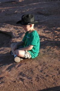 A meditative moment for Mr. T at Arches National Park.