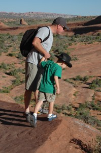 "Looking over the ledge — it is a far drop! — on the way back down from ""Delicate Arch"""